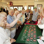 Senior residents enjoy casino night at a Hearth Management LLC community
