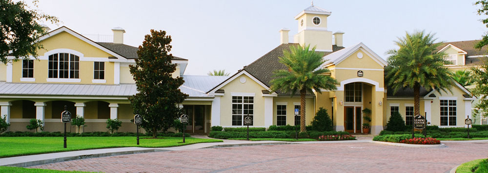 The clubhouse front entry and driveway welcomes you to apartments in Orlando