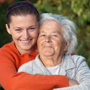 Grandmother and grandaughter hugging enjoying our Pacifica Senior Living Services in Henderson.