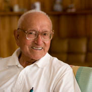 Senior man enjoys using Pacifica's residents portal to keep in touch with his family.