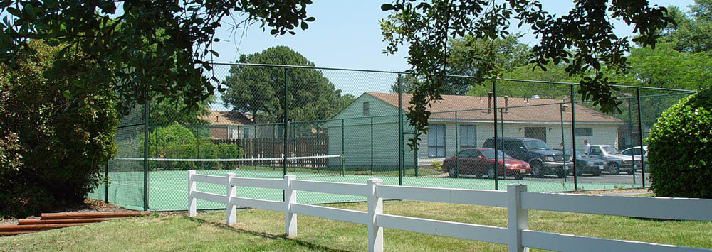 Play tennis at the courts at Brookfield Apartments