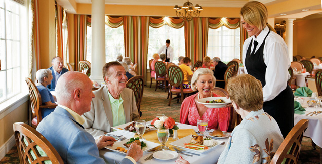 Happy residents dining assisted living community Discovery Management Group