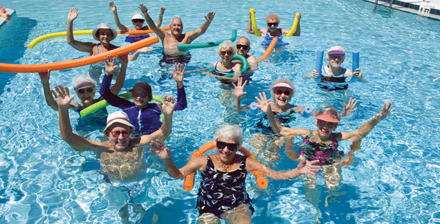 Residents enjoy pool senior retirement community Discovery Management Group