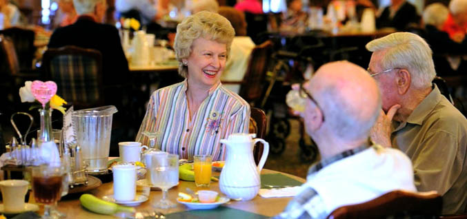 Seniors eating brunch American House Senior Living