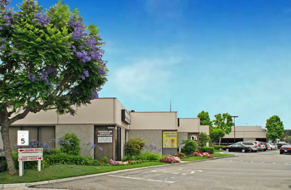View of parking lot at La Mirada commercial property for lease