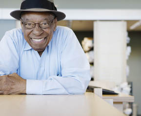 Smiling resident of a Senior Resource Group LLC Community
