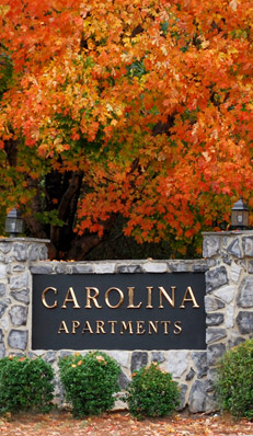The sign to Carolina Apartments in Carrboro, NC.