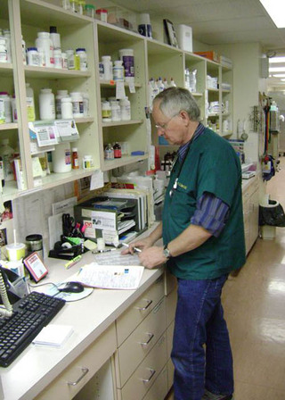 Doctor filling out paperwork at veterinary hospital in Edinboro