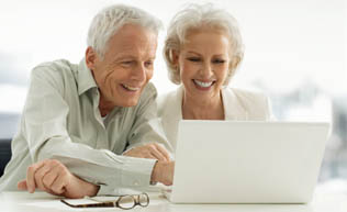 senior couple online together at Skyline Place Senior Living Sonora