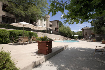 Hillside Pointe Apartments in Lakewood includes a pool and patio