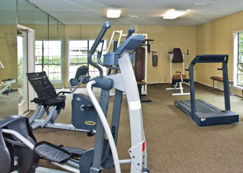 Residents at Myriad Apartments enjoy  a fitness center