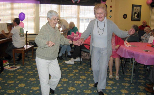 Female residents dancing The Hearth at Southbury