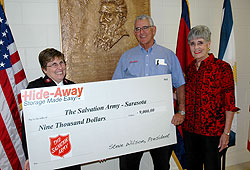 Hide Away Storage Accepts a Check Award