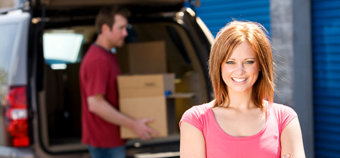 Woman moving into a storage facility at Self Storage Plus