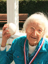 Senior women throws winning baseball at our dementia care assisted living care community in Plano, Texas.