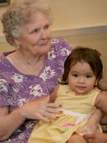 Senior holding grandchild at Silverado assisted living dementia care community in Brookfield, Wisconsin.