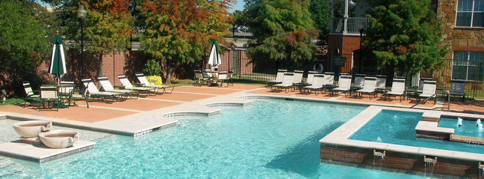 Resort-style outdoor swimming pool at apartments in Lewisville