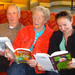 Seniors reading Highgate Senior Living