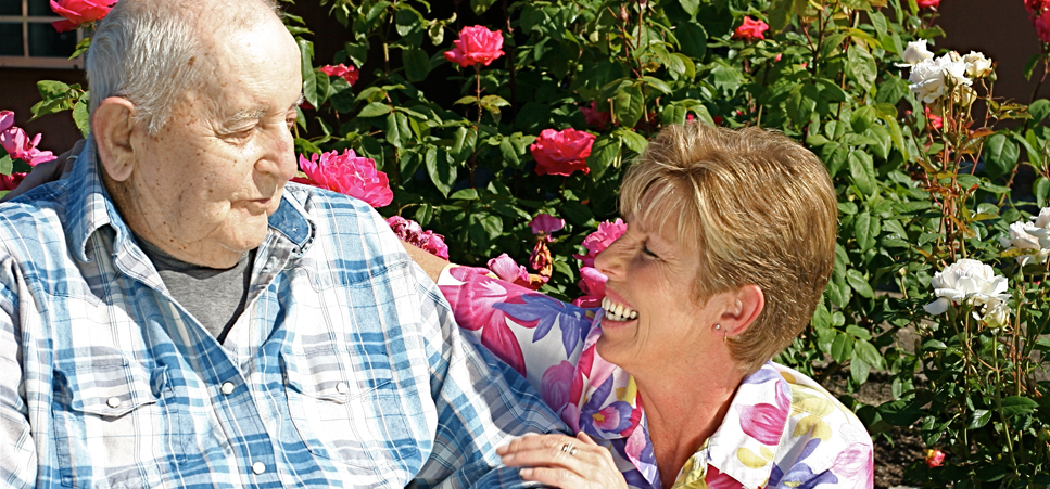 Caretaker with happy senior man at our retirement community in Albany, OR 97322