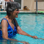 Resident swimming outside at Silverado Senior Living