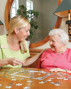 Tequesta Terrace senior living resident working on a puzzle.