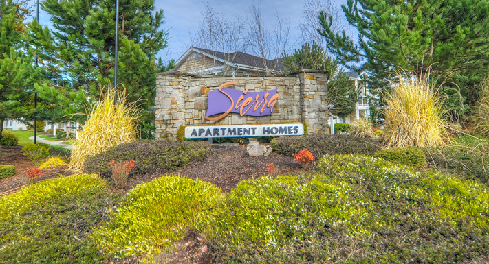 Stylish sign at entrance of puyallup apartments