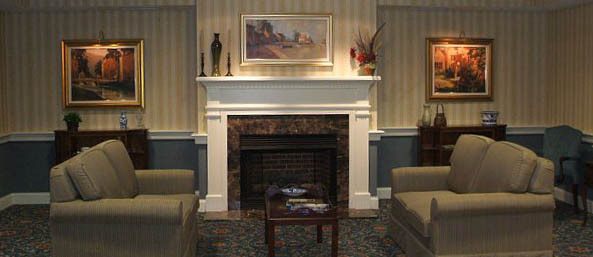Va fire place lobby Bentley Commons at Lynchburg - Independent Living
