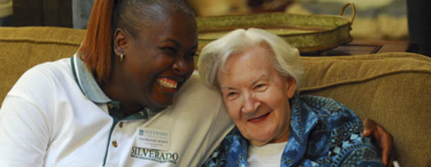 Staff hugs Silverado memory care resident at Silverado Senior Living in Plano TX