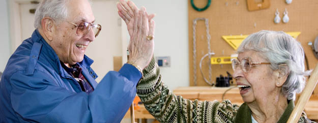 Residents giving a high five at Silverado in home health care in Los Angeles CA