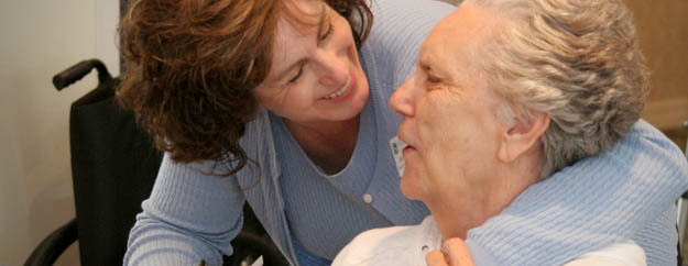 Hospice caregiver with patient at Silverado hospice care in Salt Lake City Utah
