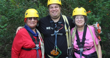 Manager with residents ziplining