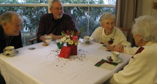 Chandler residents group at table Chandler\'s Square Retirement Community