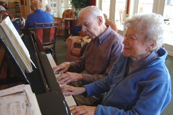 assisted living residents playing piano in Brick, NJ