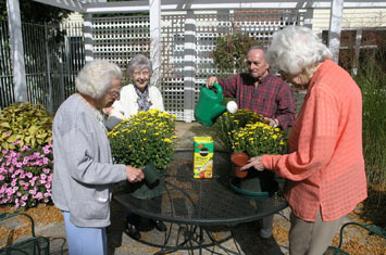 Assisted living residents enjoy planting flowers in Montville, NJ