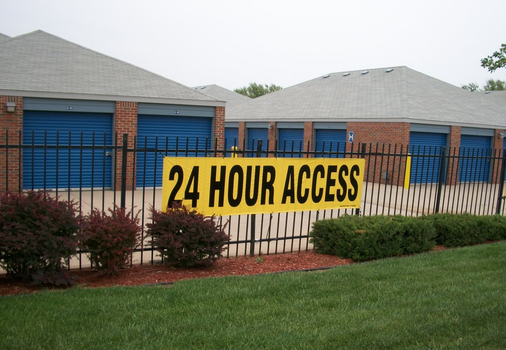 yellow 24 hour access fence sign Security Self Storage