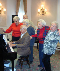 Seniors at the piano Esplanade Manhattan