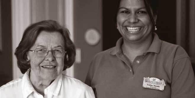 Senior woman resident and staff at assisted living community in Morristown