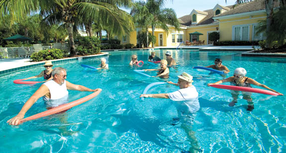 Residents enjoy water aerobics at senior living community in florida