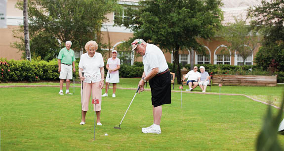 Residents of senior indepenent living community in Naples playing golf