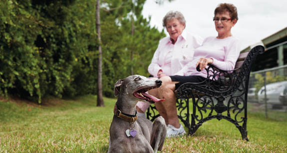Residents and dog at Aston Gardens at Pelican Marsh naples fl assisted living community