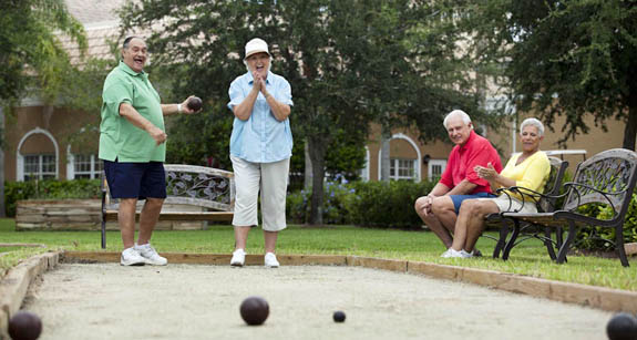 Senior residents of an independent living community in Florida enjoy a game of bocce ball