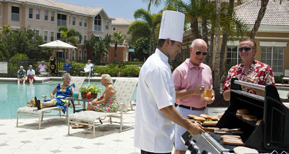 Resident BBQ at Aston Gardens at Pelican Pointe memory care community in Venice FL