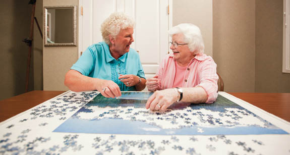 Residents of Tampa Bay assisted living community working on a puzzle