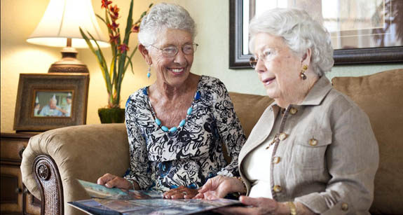 Senior women residents on couch at Aston Gardens at Tampa Bay