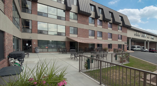 Welcoming exterior of Woodbury senior living community