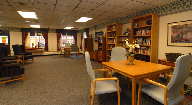 Inviting library at senior living community in Minneapolis, MN