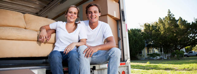 Couple packing moving truck headed for self storage in Toledo, OH