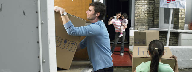 Family packing moving truck to be moved into self storage in West Adrian