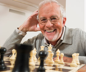 Senior enjoying a game of chess