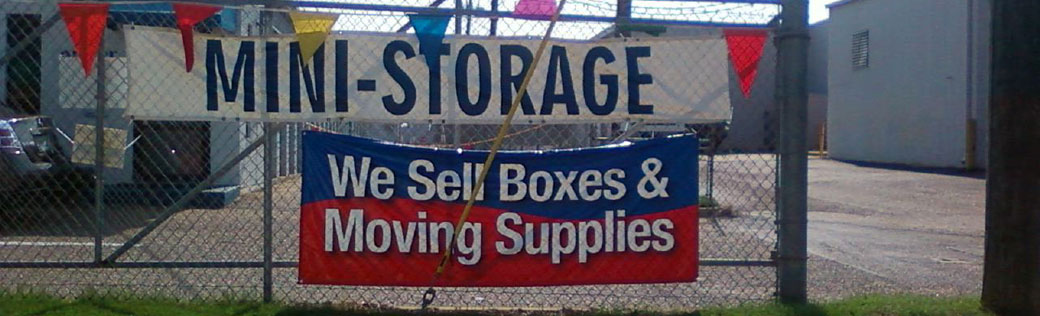 Signs on fence at Dothan Self Storage